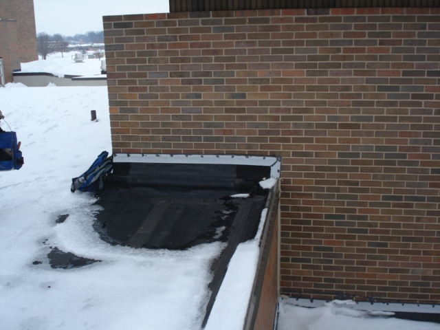 Low Slope Roof Trapped Moisture